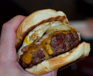 A Bacon Cheeseburger Topped With Egg!