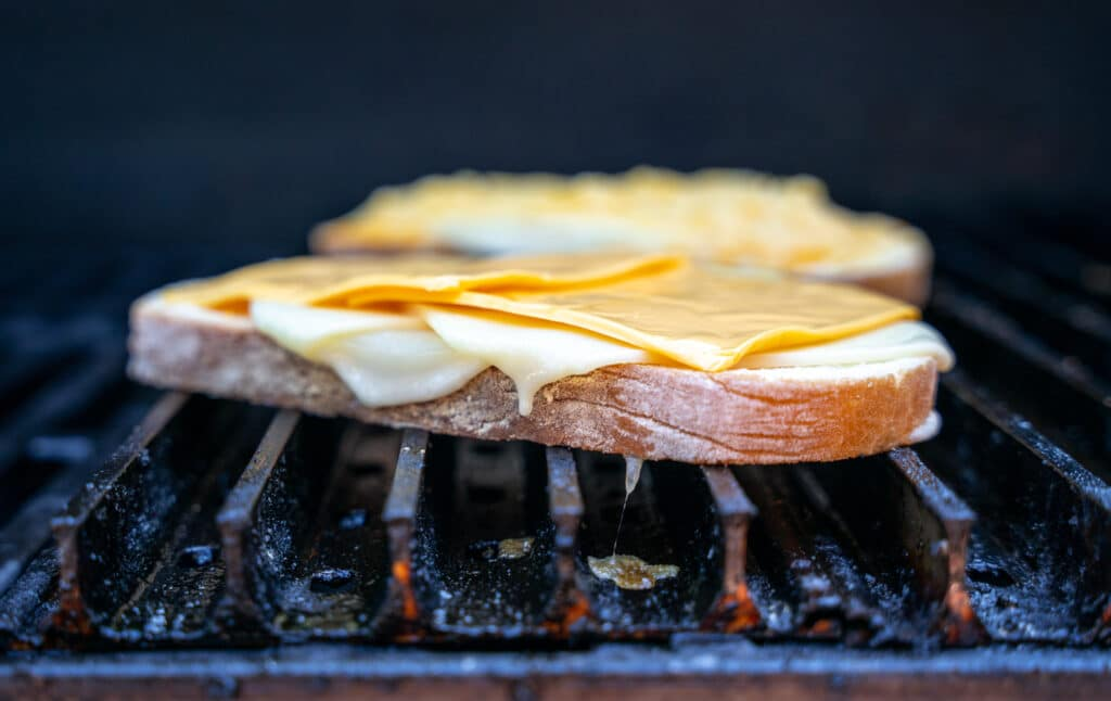 grilled cheese sandwich being made on a grill