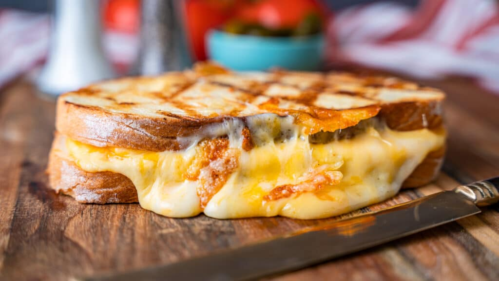 grilled cheese sandwich on a cutting board