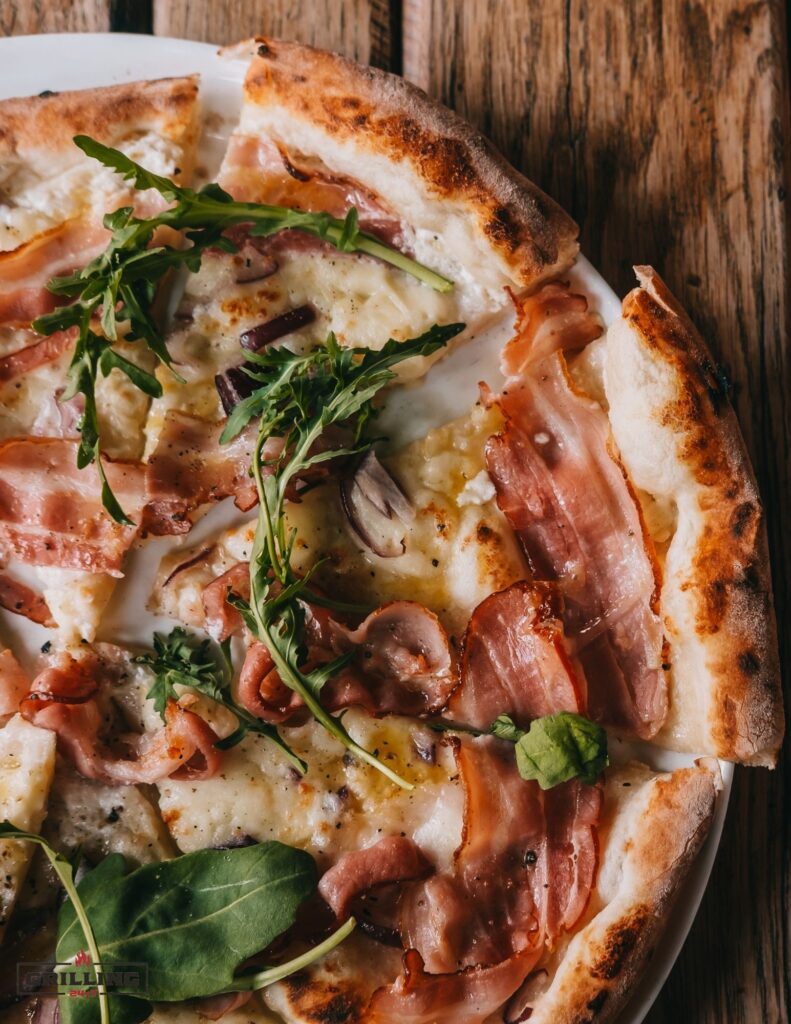 grilled pizza with arugula and prosciutto