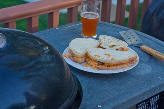 Grilled cheese on the grill with sliced brats