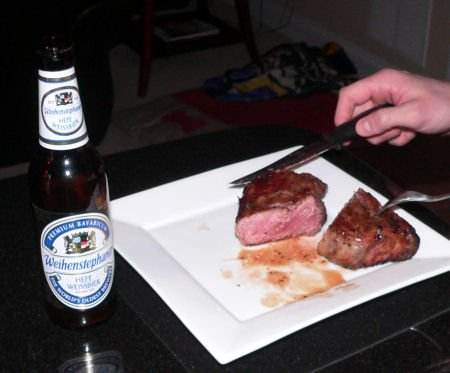 Prime New York Strip Steaks on a charcoal grill - Grilling24x7.com