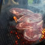 Bone-in ribeye steaks on the charcoal grill - grilling24x7.com