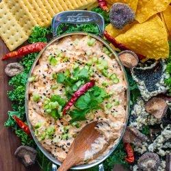 bang bang shrimp dip with crispy seaweed chips and crackers