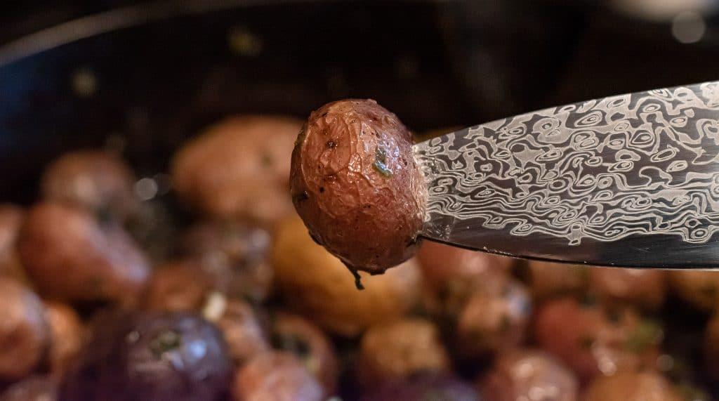 roasted potato on tip of knife