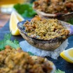 Smoked Clams Casino served on a bed of kosher salt