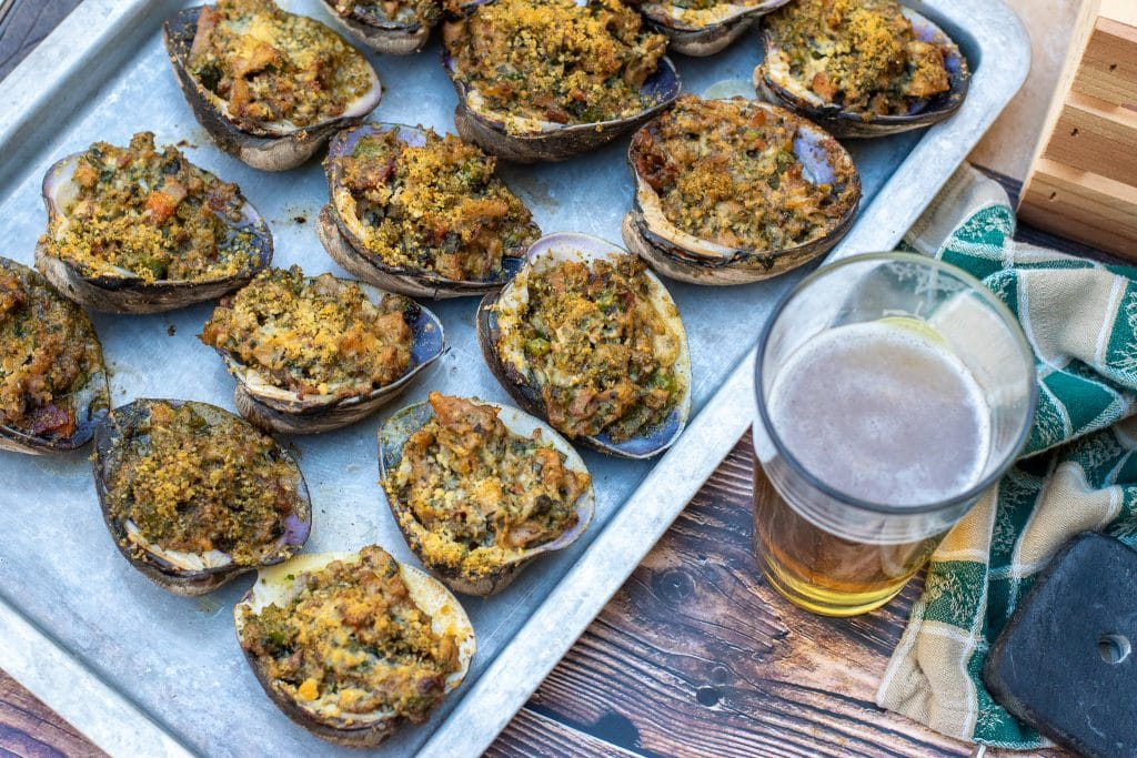 clams casino served with a cold beer