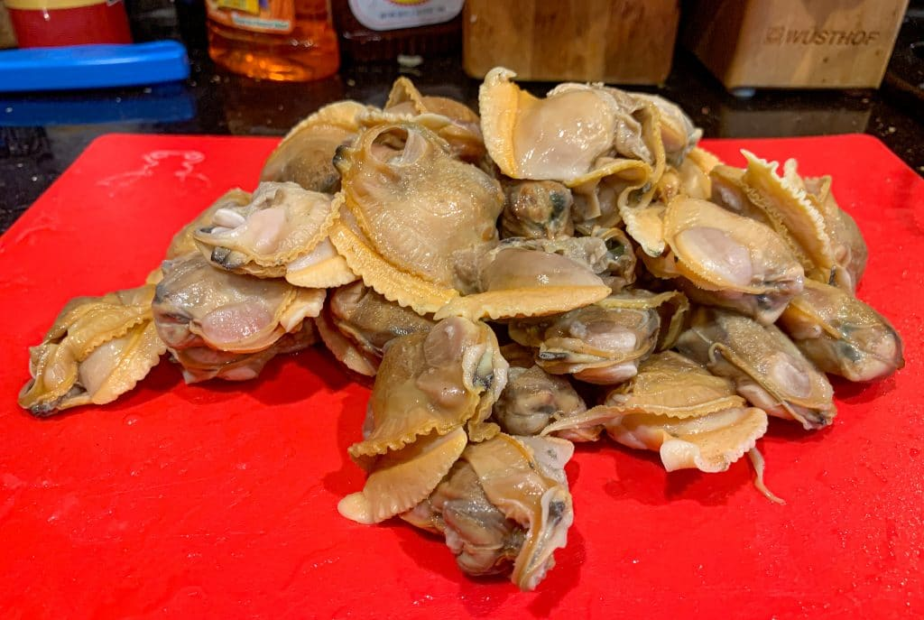cherrystone clams out of the shell about to be chopped for clams casino