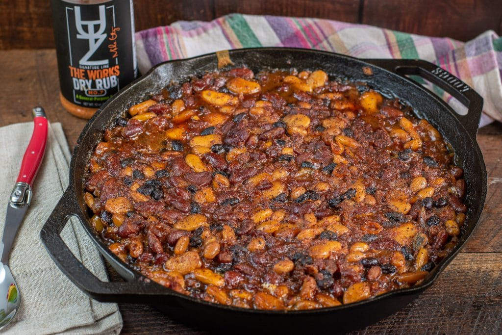 Cast iron smoked barbecue beans with sausage