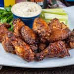 dipped smoked wing in ranch dressing glazed with honey old bay