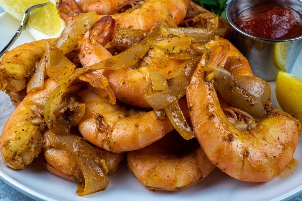 Braised shrimp with white onions beer and old bay