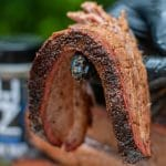 Sliced beef brisket bend test showing tenderness and smoke ring