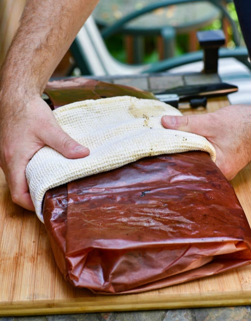 smoked beef brisket wrapped in peach butcher paper