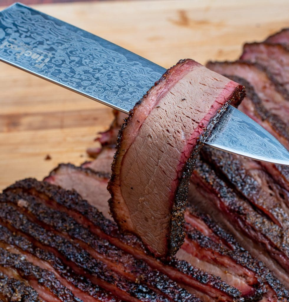 sliced beef brisket exposing smoke ring