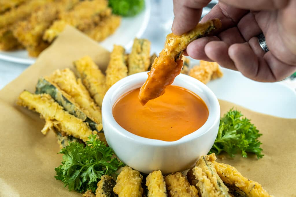 dipping zucchini fries in vodka sauce