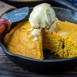 Pumpkin Cornbread with bourbon maple butter in a cast iron skillet