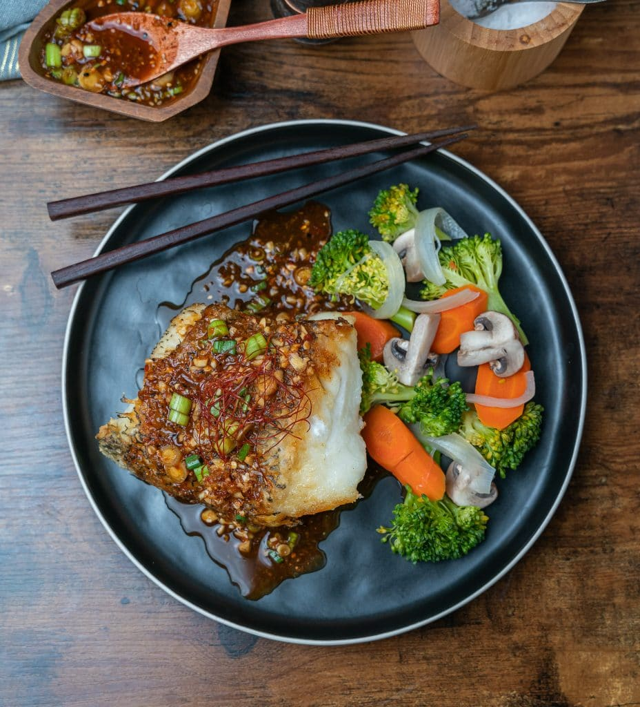 pan seared chilean sea bass served with steamed veggies and hoisin vinaigrette