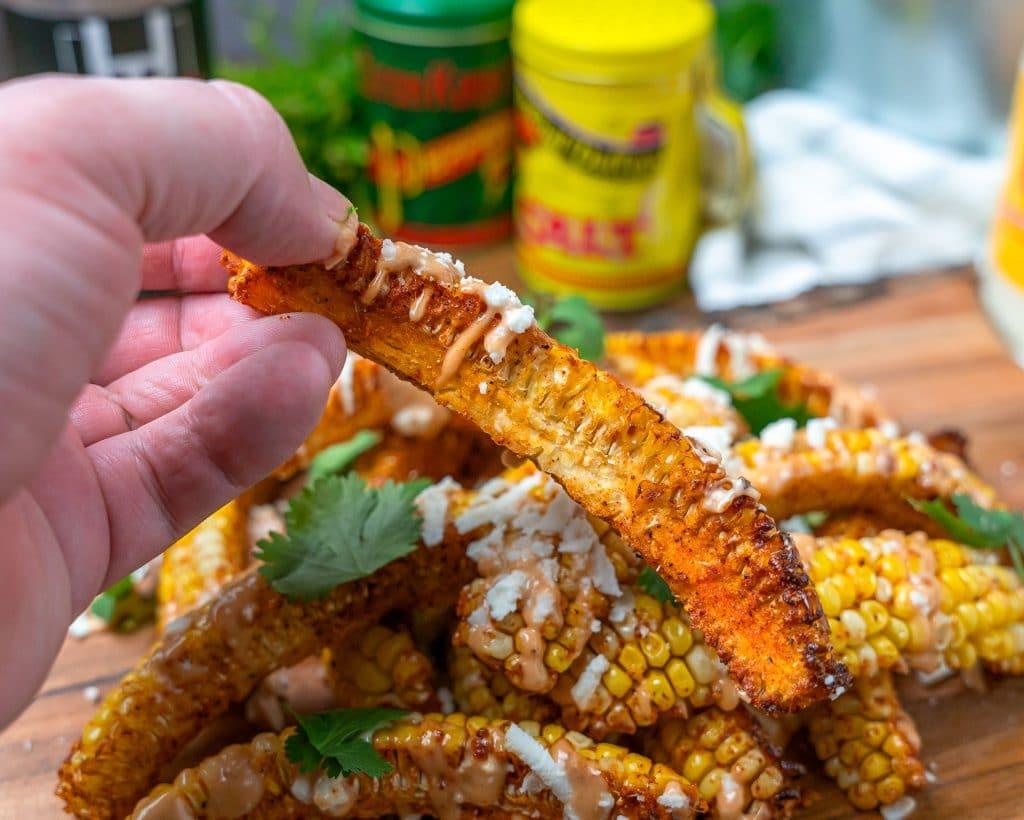 BBQ corn rib picking it up to eat