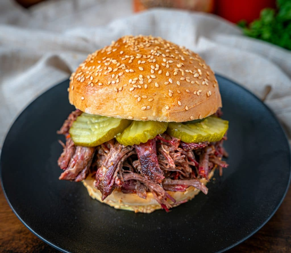 smoked pulled chuck roast sandwich with pickles