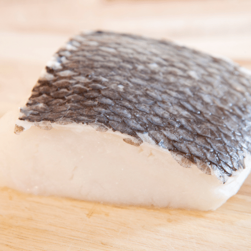 raw filet of Chilean Sea Bass ready to sear