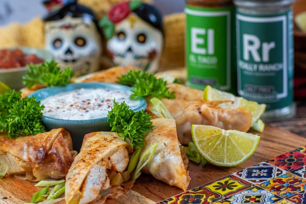Chicken fajita egg rolls in the air fryer served with each dipping sauce