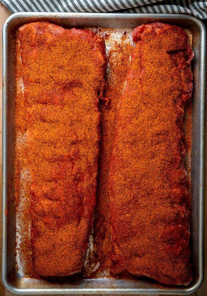 seasoned ribs ready to go on the smoker