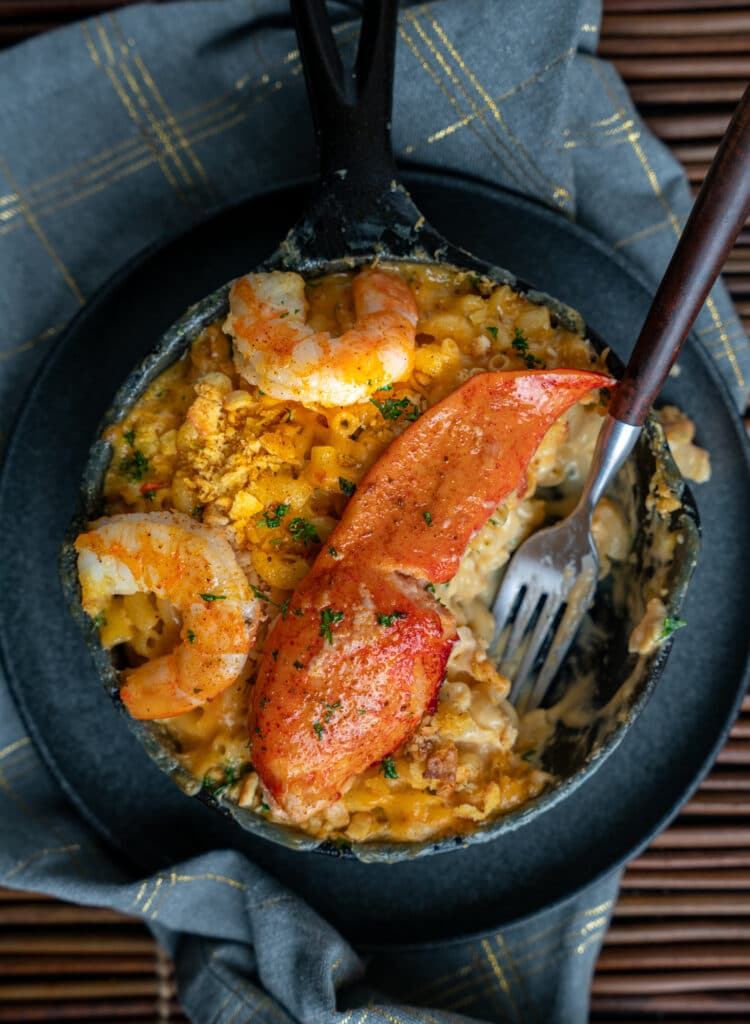 Seafood Mac and cheese recipe served in a cast iron skillet