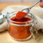 scooping bbq pork dry rub with a spoon