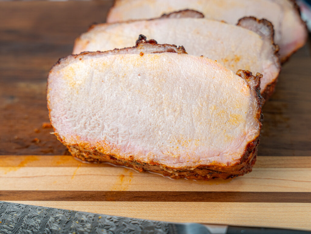slices of smoked pork loin on a cutting board