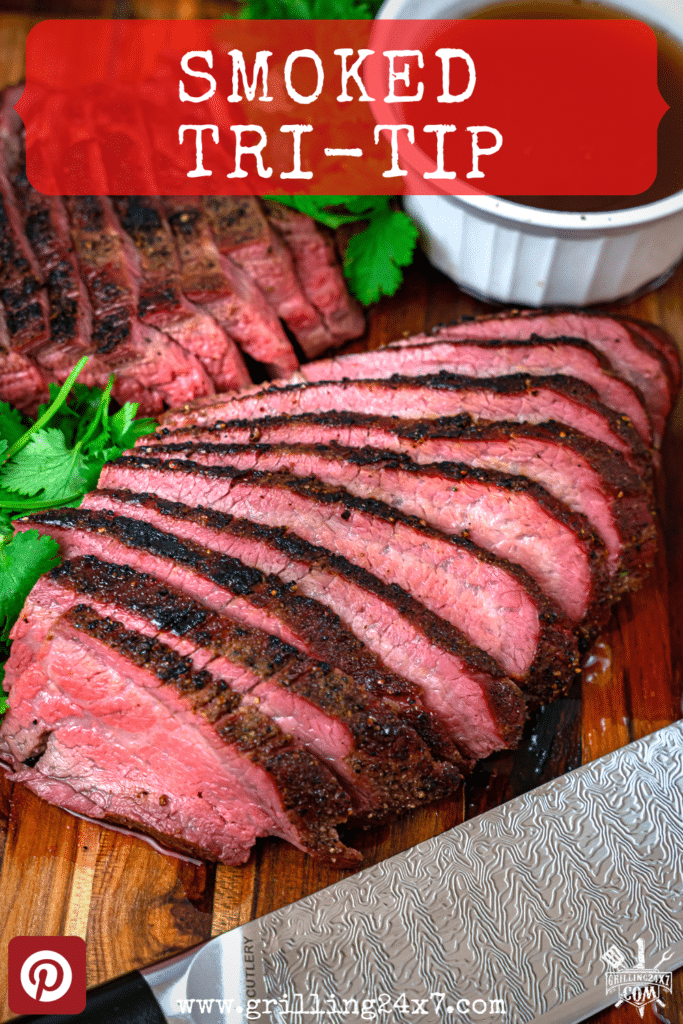 smoked Tri Tip with a knife sliced on a board