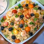 southwestern pasta salad made with farfalle pasta , cheddar cheese, tomatoes and black olives