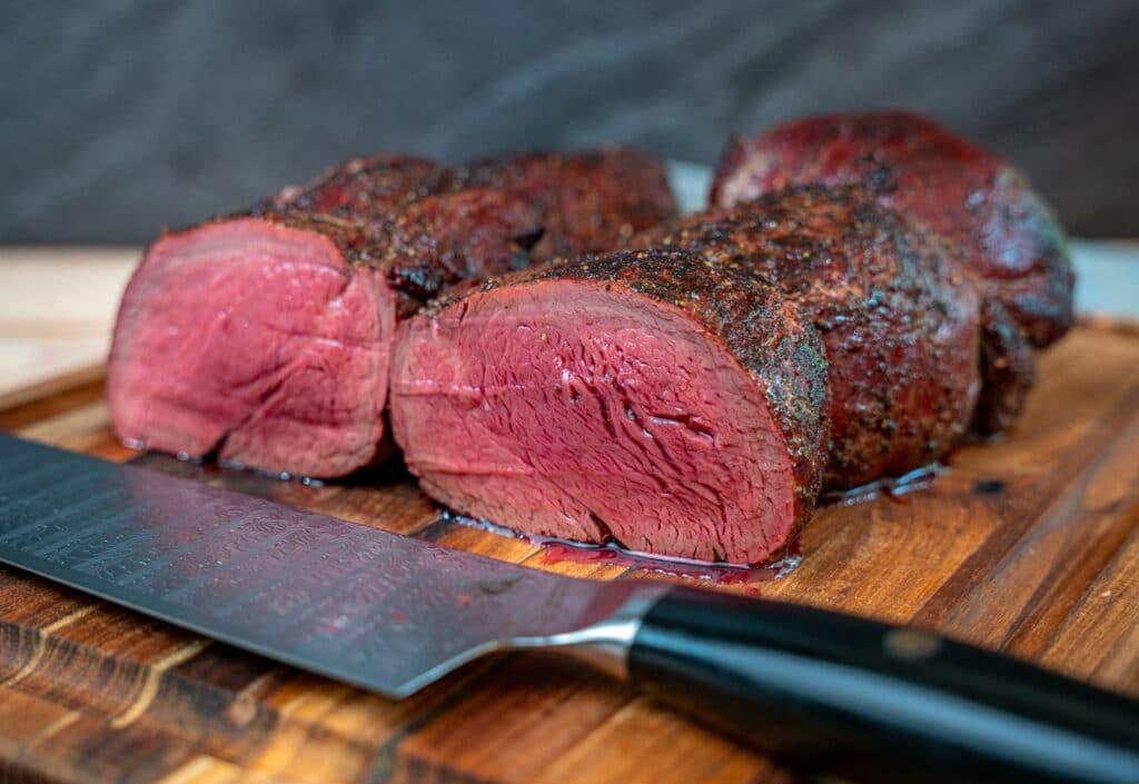 beef tenderloin sliced on a cutting board