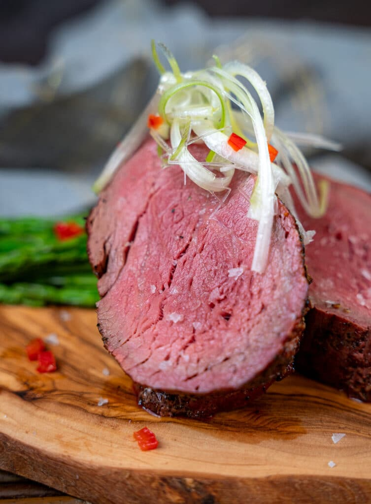 smoked beef tenderloin topped with sea salt and sliced scallions