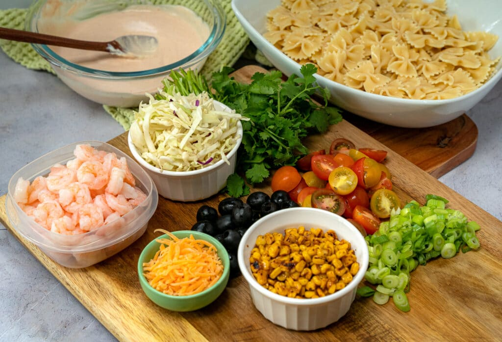pasta salad ingredients on a cutting board