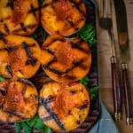 grilled peaches on a wooden tray with beautiful grill marks