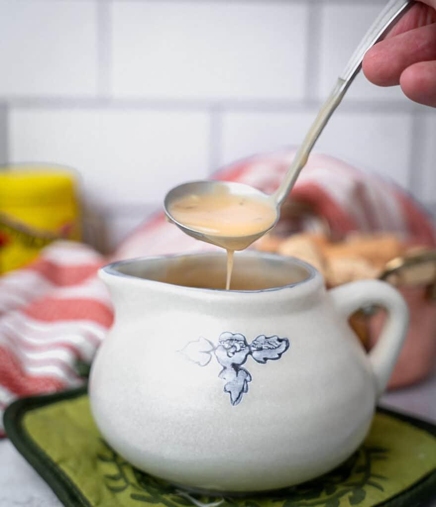 pot liquor gravy dripping off a ladle